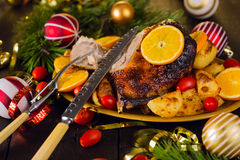 Christmas baked duck served with potatoes, orange and tomatoes Stock Image