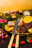 Christmas baked duck served with potatoes, orange and tomatoes Stock Images