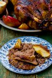 The Christmas baked goose with apples Stock Images