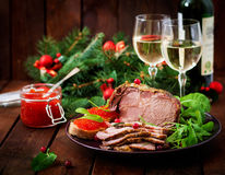Christmas baked ham and red caviar. Served on the old wooden table Royalty Free Stock Photos