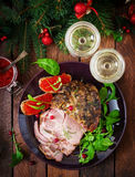 Christmas baked ham and red caviar, served on the old wooden table. Stock Image