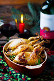 The Christmas baked quails with mushrooms Royalty Free Stock Image