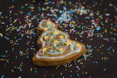 Christmas bakery. Friends decorating freshly baked gingerbread cookies with icing and confectionery mastic, view from above. Festi stock photos