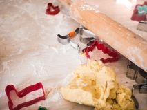 Christmas bakery: top view shot of cookie dough and different ba stock image