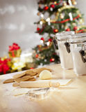 Christmas baking. Baking chrismas cookies. Christmas tree and gifts on background Royalty Free Stock Photography