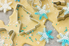 Christmas baking background: dough, cookie cutters and snowflake Stock Photography