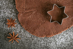 Christmas baking background dough, cookie cutters with spice. Viewed from above. Stock Photos