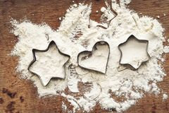 Christmas baking background with flour,  cookie  cutter. Christmas baking background with flour, rcookie cutter and rustic bake pan, top view, place for text Royalty Free Stock Photos