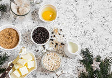 Christmas baking background. Flour, sugar, butter, rolled oats, eggs, chocolate chips on a light background. Stock Photography