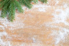 Christmas baking background with sugar and fir on cutting board stock photo