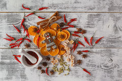 Christmas - baking cake background. Blank opened cook book with. Food ingredients and decorations around on vintage planked wood table from above. Layout with Stock Photos