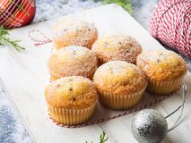Christmas baking muffins with icing sugar Stock Image