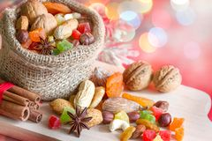 Christmas baking concept with nuts and dried fruits in the kitchen royalty free stock photos