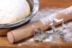 Christmas baking: cookie cutters, dough, rolling pin Royalty Free Stock Photos