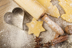 Christmas baking, cookies, rolling pin and  spices on wood Stock Photography