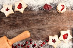 Christmas baking double border with Linzer jam cookies royalty free stock photos