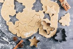 Christmas baking. Dough and form for ginger cookies. Culinary background. Top view Stock Photo