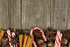 Christmas baking goods and candies border over rustic wood Royalty Free Stock Photo