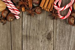 Christmas baking goods and candies border over rustic wood Stock Photos