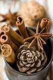 Christmas Baking Ingredients Cinnamon Sticks Anise Star Walnuts Cloves Pine Cone in Vintage Jug on Wood Background Royalty Free Stock Photography