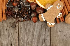 Christmas baking ingredients and gingerbread man border on rustic wood stock image