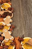 Christmas baking ingredients with gingerbread men corner border on wood Stock Photos