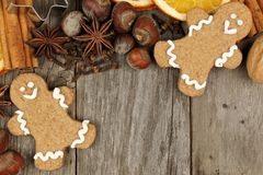 Christmas baking ingredients with gingerbread men over rustic wood Royalty Free Stock Photo