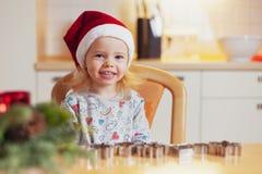 Christmas baking. Little girl at christmas bakery stock image