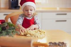Christmas baking. Little girl at christmas bakery stock photography
