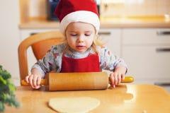 Christmas baking. Little girl at christmas bakery royalty free stock photo
