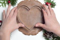Christmas Baking. Making Heart Shaped Christmas Gingerbread Cookies. Royalty Free Stock Photos