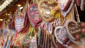 Christmas baking, many beautiful tasty holiday glazed biscuits with inscriptions in packs on street shop for tourists stock video footage