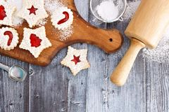 Christmas baking overhead scene with Linzer jam cookies Royalty Free Stock Photography