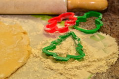 Christmas baking preparations and cookie cutters in flour Stock Images