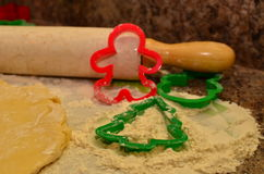 Christmas baking preparations and cookie cutters in flour Stock Photography