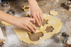 Christmas baking, prepare  child the cake Royalty Free Stock Photos
