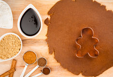 Christmas Baking. Traditional Christmas gingerbread cookies, dough, and spices with happy Gingerbread man and cookie cutter royalty free stock photo