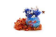 Christmas ball. Blue Christmas ball with red tinsel isolated on white Royalty Free Stock Image