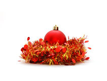 Christmas ball. Red Christmas ball with red tinsel isolated on white Stock Photos