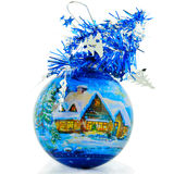 Christmas Ball. With the drawn small house in a snow and decorated by a brilliant tape Royalty Free Stock Photos