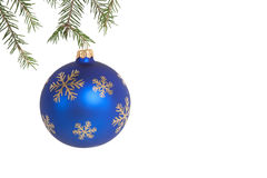Christmas ball. Blue christmas ball on green fir branch over white isolated stock photos