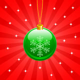 Christmas ball. Green christmas ball on red background Stock Images