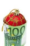 Christmas ball. A christmas ball with euro bills symbolizing cosumerism Stock Photos