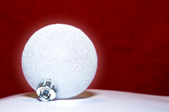 Christmas ball. White crystal christmas ball with red background royalty free stock photography