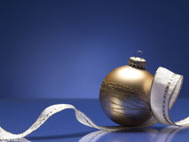 Christmas ball. On the blue background Royalty Free Stock Image