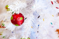 Christmas ball. Hanging on a white Christmas tree Royalty Free Stock Photos