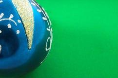 Christmas ball 3. Christmas ball in green velvet background Stock Photography
