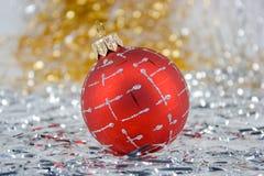 Christmas ball. Red Christmas ball on shiny background Stock Photo