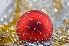 Christmas ball. Red Christmas ball on shiny background Stock Image
