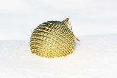 Christmas ball. In snow at christmastime Royalty Free Stock Image